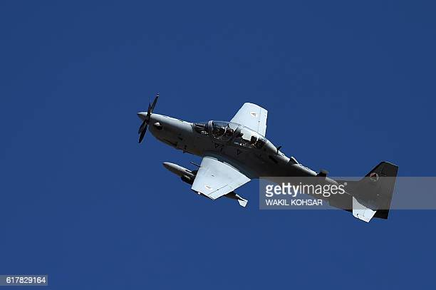 In this photograph taken on October 18 an Afghan Air Force Embraer A29 Super Tucano aircraft flies during an airstrike training mission on the...