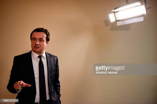 In this photograph taken on October 2 Albin Kurti the leader of Vetevendosje party gestures as he speaks during an interview with AFP in Pristina...