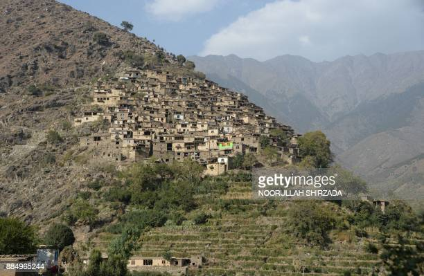 In this photograph taken on October 21 2017 this general view shows houses in the remote village of Shemol in the eastern province of Nangarhar...