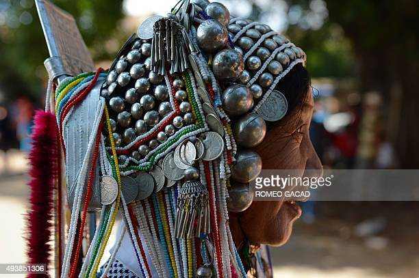 In this photograph taken on October 22 Me Gan a 56 year old Shan ethnic woman from the Akha hill tribe wearing traditional costumes and silver head...