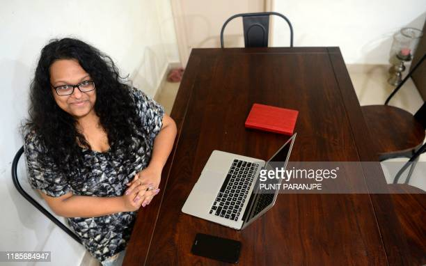 In this photograph taken on October 26 2019 Vandita Morarka poses for a picture as she sits around rented furnitures during an interview with AFP in...