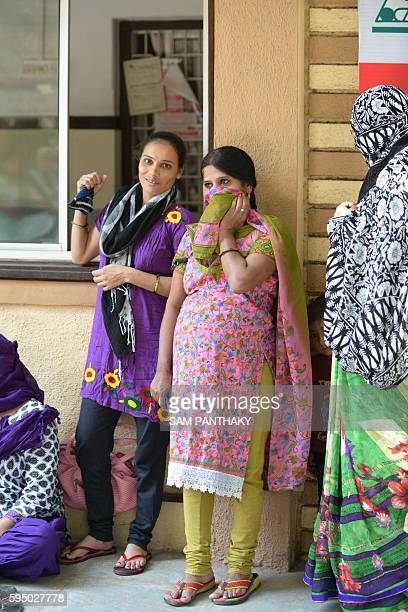 In this photograph taken on October 29 Indian surrogate mothers gather during a peaceful protest on the campus of Dr Nayana Patel's Kaival Hospital...