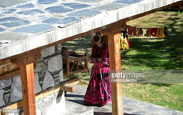 In this photograph taken on October 31 a Kalash woman takes care of her child in Bashali building where traditionally villagers spend time during the...