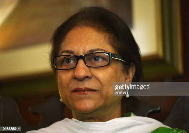 In this photograph taken on October 4 Pakistani human rights activist and Supreme Court lawyer Asma Jahangir gestures during an interview with AFP in...