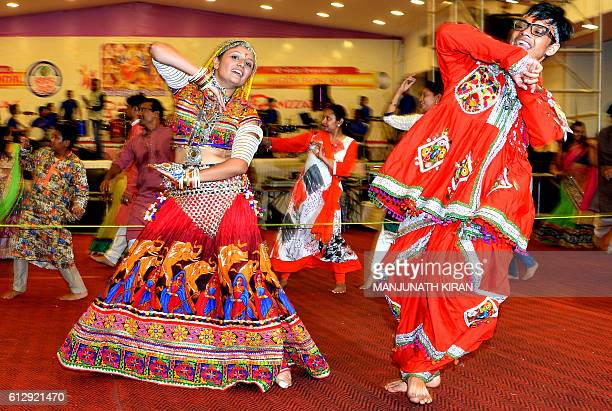 In this photograph taken on October 5 Gujarati dancers perform the 'dandiya raas' during the celebration of the nineday 'Navaratri' festival in...