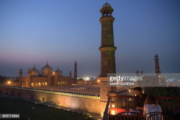 In this photograph taken on October 6 tourists visit historic Badshahi Mosque in the Lahore Lahore which once served as the capital of the Mughal...