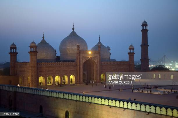 In this photograph taken on October 6 tourists visit the historic Badshahi Mosque in Lahore Lahore which once served as the capital of the Mughal...