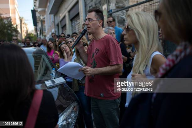 In this photograph taken on October 7 Greek historian Menelaos Charalampidis speaks to the audience during a historical walking tour in the centre of...