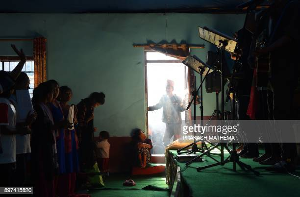 In this photograph taken on October 8 Nepali Christians take part in a church service in Lapa village in Dhading some 100 kms northwest of Kathmandu...