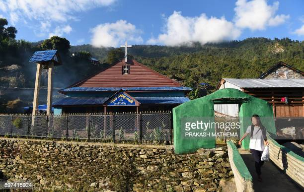 In this photograph taken on October 8 Nepali girl walks from a church in Dhading some 100 kms northwest of Kathmandu Despite strict laws that ban...