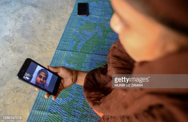 In this photograph taken on October13 Rohingya refugee Umme Khair, who gave money to a communityleader to travel to Malaysia to her husband,...
