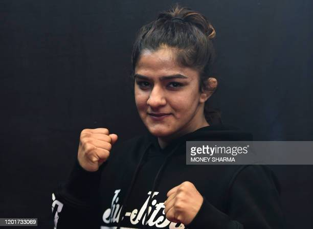 In this photograph taken on on February 12 Indian mixed martial arts fighter Ritu Phogat poses for a picture during an interview with AFP in New...