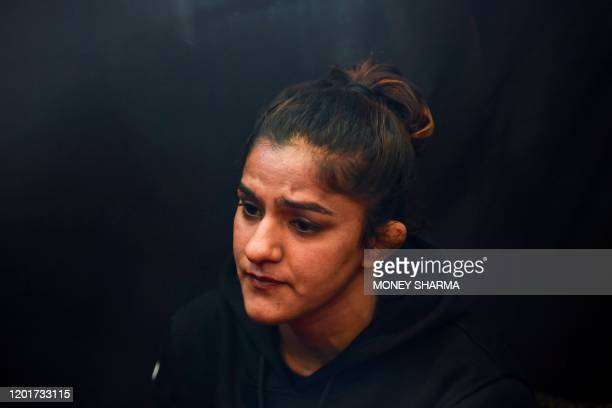 In this photograph taken on on February 12 Indian mixed martial arts fighter Ritu Phogat speaks during an interview with AFP in New Delhi Indian...