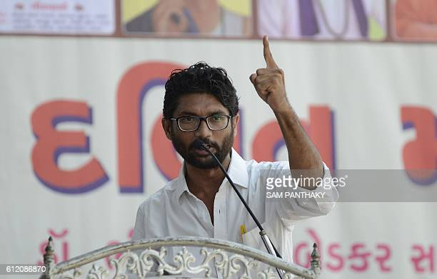 In this photograph taken on September 10 Indian Dalit leader Jignesh Mewani gestures as he delivers a speech at a Dalit rally in Ahmedabad On the...