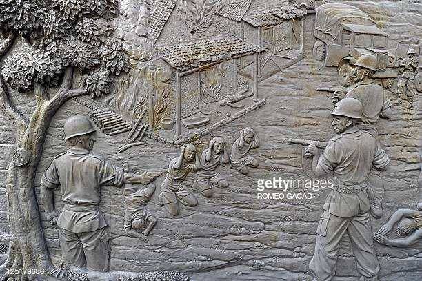 In this photograph taken on September 15 a mural depicting the 1947 massacre by Dutch military troops of Indonesians is displayed at the Rawagede...