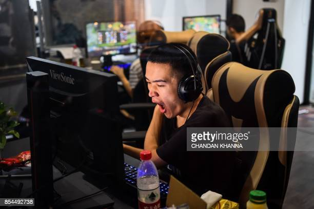 In this photograph taken on September 20 an eSports gamer plays League of Legends during training for the League of Legends World Championship at a...