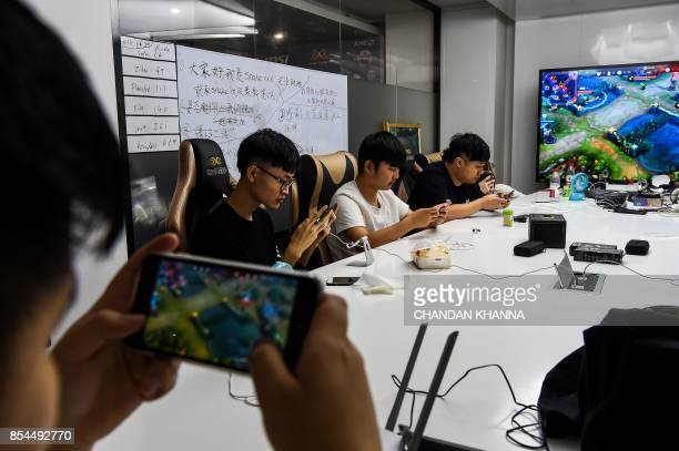 In this photograph taken on September 20 eSports gamers play League of Legends during training for the League of Legends World Championship at a boot...