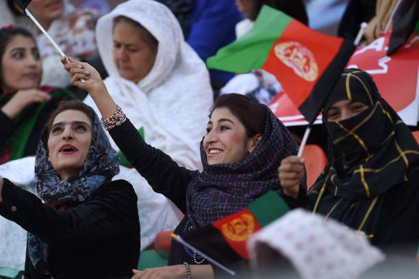 In this photograph taken on September 21 Afghan football fans watch a Roshan Afghan premiere league match between Toofan Harirod and Simorgh Alborz...