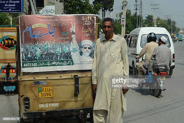 WITH PAKISTAN POLITICS TRANSPORT BY In this photograph taken on September 23 Pakistani rickshaw driver Mohammad Yaqoob poses alongside a poster...