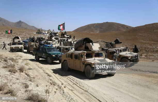 In this photograph taken on September 24 Afghan security personnel take part in a patrol during an operation against Taliban militants in the Jaghatu...