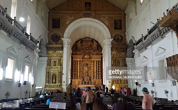 In this photograph taken on September 24 vistors walk through the Church of St Francis Xavier also known as the Bom Jesus Church in Old Goa / AFP /...