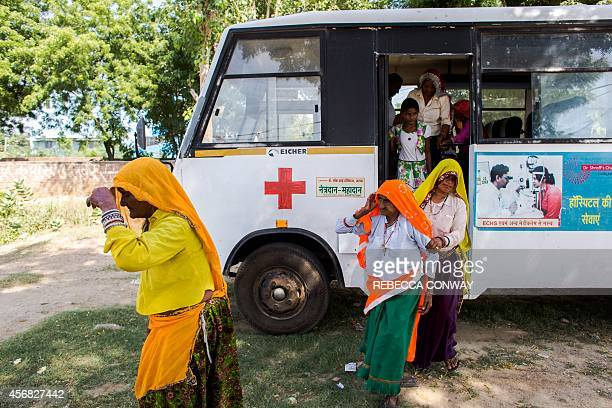 In this photograph taken on September 26 Indian patients patients referred for consultation and treatment arrive from Nagledi village in Rajasthan's...