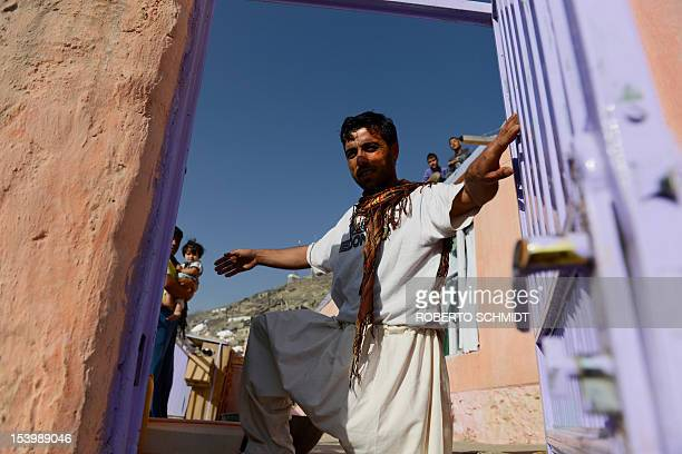 In this photograph taken on September 27 Ahmad an Afghan man who lives in the hill side neighbourhood of Jamal Mina and makes a living by making and...