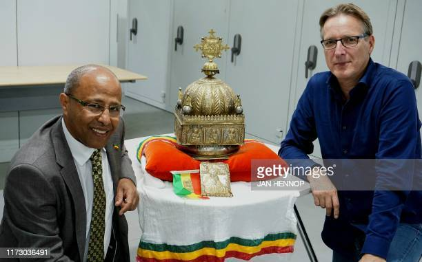 In this photograph taken on September 27 DutchEthiopian Sirak Asfaw and Dutch art detective Arthur Brand pose with an 18thcentury Ethiopian crown at...