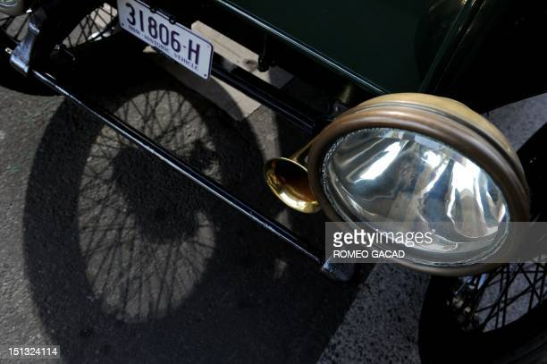 In this photograph taken on September 5 a detail of the headlight and bumper of a 1915 Detroit electric car owned by Bill Lloyd a retired Australian...