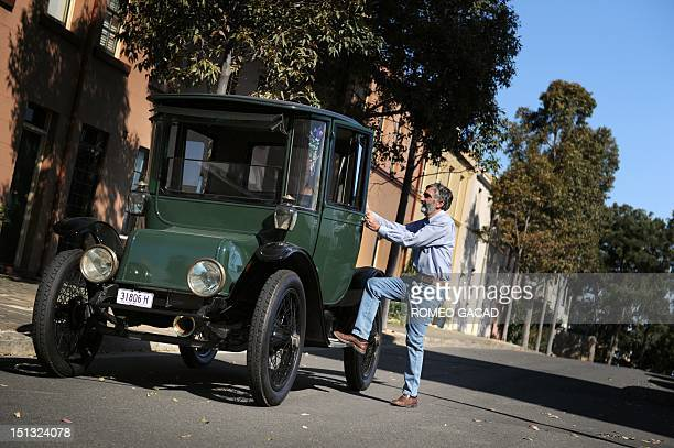 In this photograph taken on September 5 Bill Lloyd a retired Australian mechanical engineer, patent attorney and vintage car collector steps inside...
