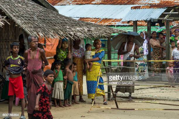 In this photograph taken on September 7 minority Muslim Rohingya gather at the Thet Kae Pyin displacement camp in Sittwe after the Rakhine State has...