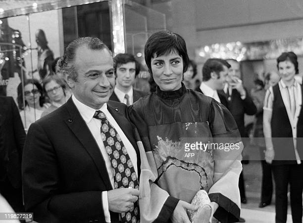 In this photograph taken on September 8 1971 Greekcypriot film director Michael Cacoyannis poses with Greek actress Irene Papas during the premiere...
