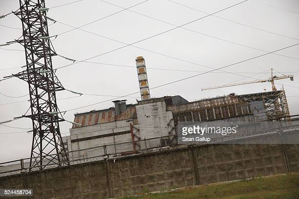 In this photograph taken through a bus window the sarcophagus that encloses stricken reactor number four stands at the Chernobyl nuclear power plant...