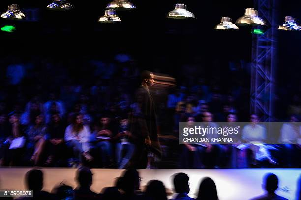 In this photograph taken with a slow shutter speed a model presents a creation by Indian fashion designer Gaurav Jai Gupta during the Amazon India...