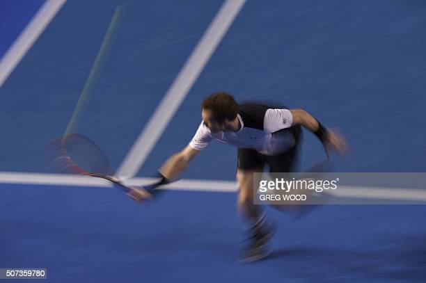 In this photograph taken with a slow shutter speed, Britain's Andy Murray plays a backhand return during his men's singles semi-final match against...