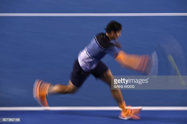 In this photograph taken with a slow shutter speed Canada's Milos Raonic plays a forehand return during his men's singles semifinal match against...