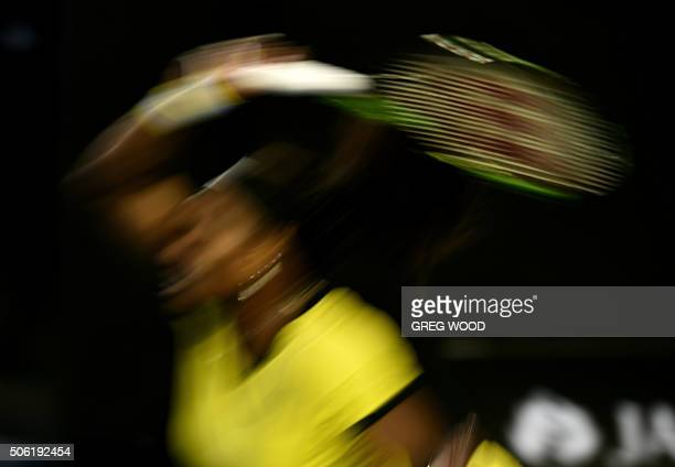 In this photograph taken with a slow shutter speed Serena Williams of the US plays a forehand return during her women's singles match against...