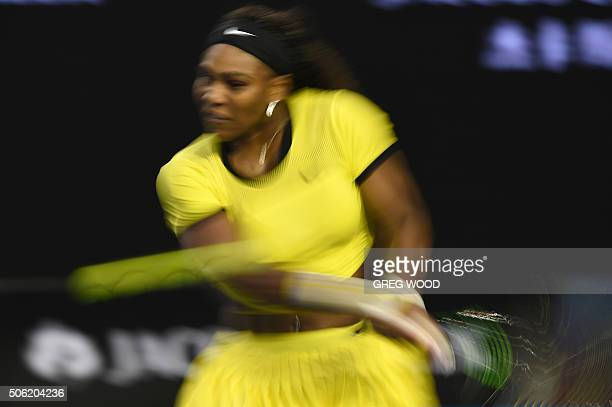 In this photograph taken with a slow shutter speed Serena Williams of the US plays a backhand return during her women's singles match against...
