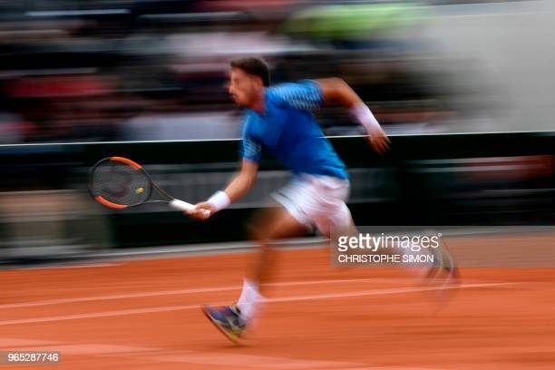 In this photograph taken with a slow shutter speed Spain's Pablo Carreno Busta prepares to play a forehand return to Italy's Marco Cecchinato during...