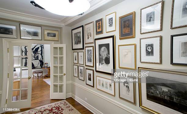 In this photograph, the entry hallway to Kate Hendrickson's apartment is shown. Hendrickson, a local art dealer, believes in decorating her walls...