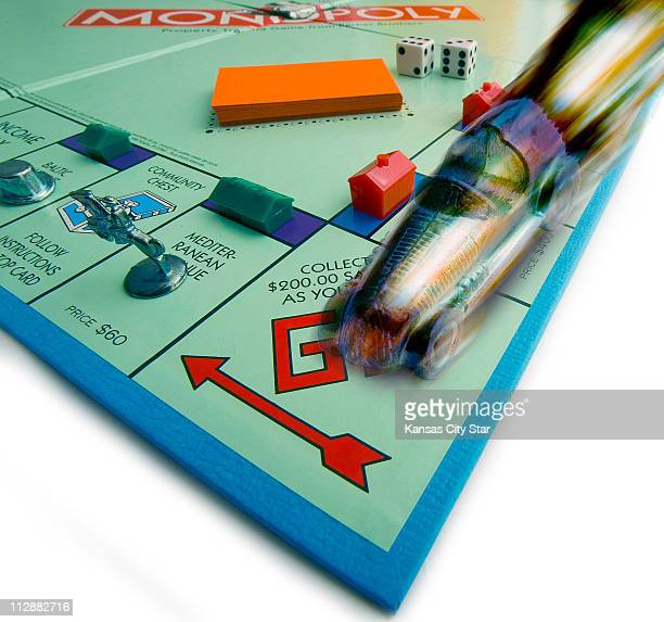 In this photograph the racecar marker zooms around the Monopoly board game If you want to speed up playtime try Hasbro's Express series of...