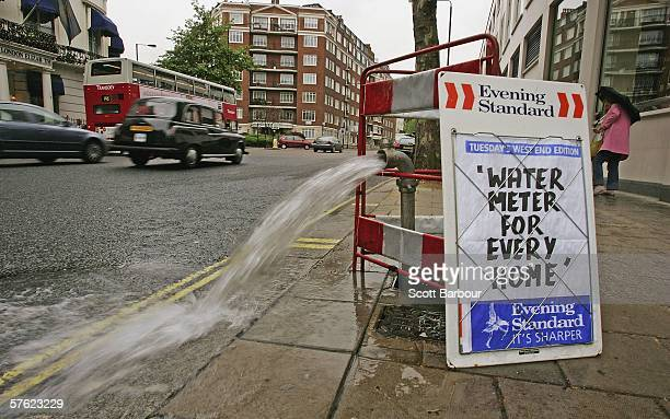 In this photo-illustration, a burst pipe spews water onto a street beside an Evening Standard news-board near Lancaster Gate on May 16, 2006 in...