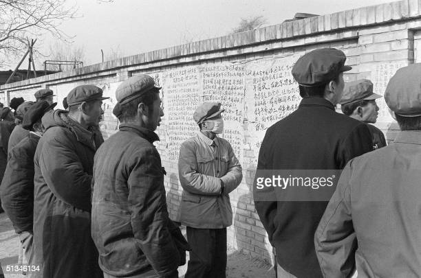 In this picture dated 05 December 1978 during the early days of the democracy movement in China people read posters hanging on the famous 'Democracy...