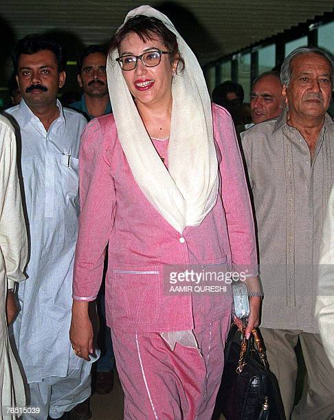 In this picture dated 26 July 1998 former Pakistani premier Benazir Bhutto arrives from Dubai to a rousing welcome by her party supporters at Karachi...