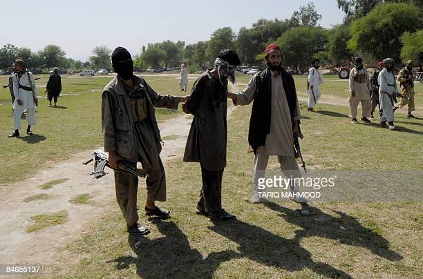 In this picture dated April 27, 2008 Pakistani Taliban escort a kidnapper as they arrive for his execution at the Rahim Kor village near the Mammad...