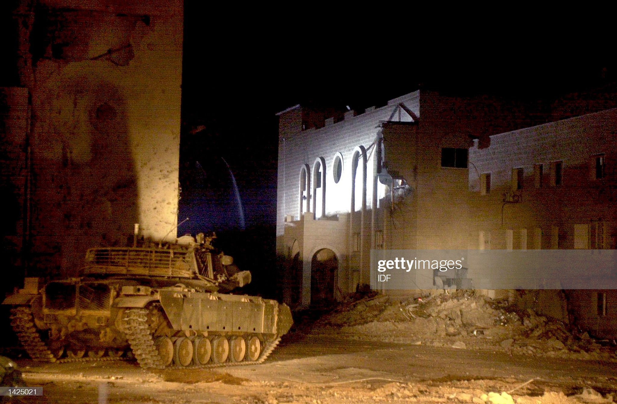 https://media.gettyimages.com/photos/in-this-picture-distributed-by-the-idf-an-israeli-tank-stands-guard-picture-id1425021?s=2048x2048