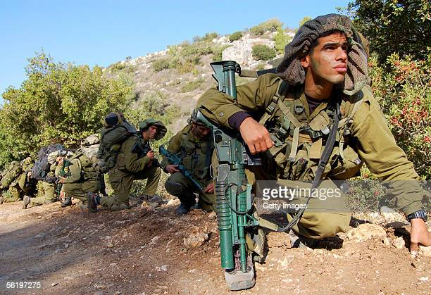In this picture distributed by the IDF, Israeli soldiers from the Golani infantry brigade take part in a training exercise November 17, 2005 in the...