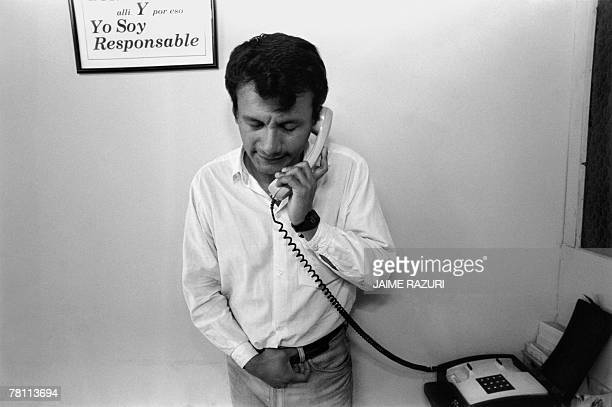 In this picture from June 1995 Cesar an HIV positive person talks by phone at an Alcoholics Anonymous centre in Lima Cesar also a gay person made a...