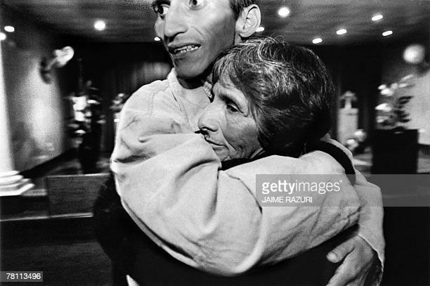 In this picture from November 2002 Lucho HIV positive embraces his mother after being baptized as evangelist in a poor neigborhood fo Lima Lucho was...