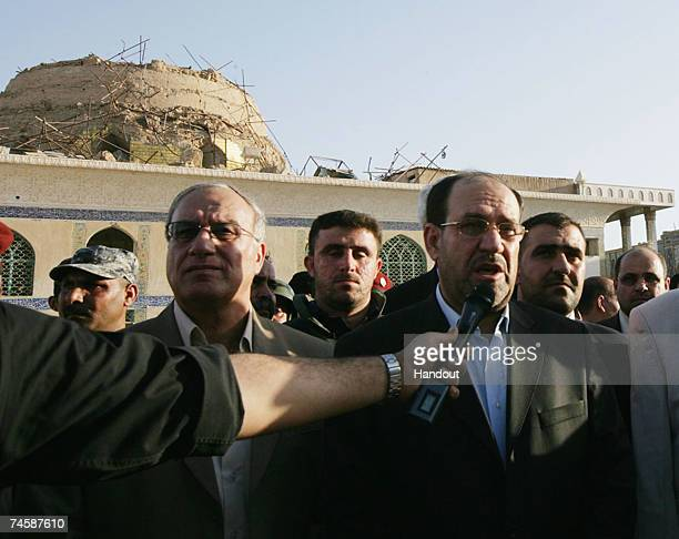 In this picture handout image from the Iraqi Prime Minister's office Iraqi PM Nouri alMaliki talks to reporters at the shrine of the Askariya mosque...